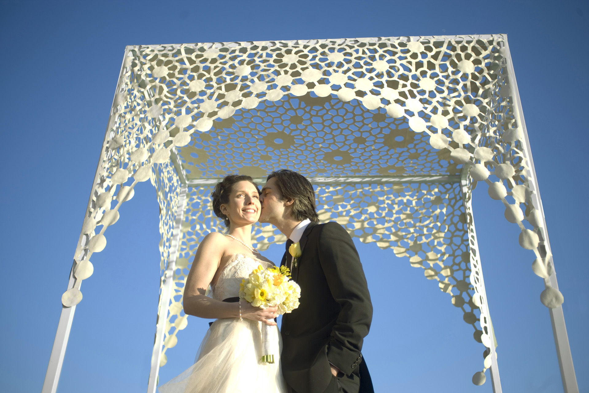 A chuppah or any nonJewish marriage canopy transforms the space below into
